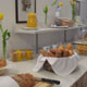 Breakfast buffet with freshly-baked rolls, croissants, bacon, cheese, fruits, yoghurt and muesli